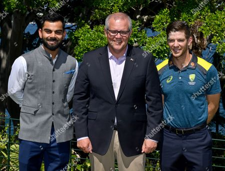 India's cricket captain Virat Kohli, Australian Prime Minister Scott Morrison and Australia's cricket captain Tim Payne at a New Year's Day Cricket Reception for Australia's and India's cricket teams at Kirribilli House in Sydney, New South Wales, Australia, 01 January 2018.