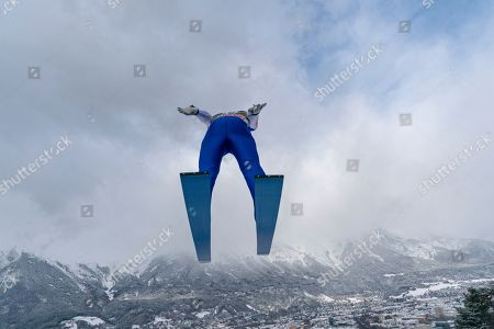 David Siegel of Germany  soars through the air during a practice jump for the third stage of the 67th Four Hills Tournament in Innsbruck, Austria, 03 January 2019.