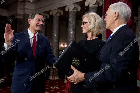 Mike Pence, John Barrasso, Bobbi Brown. Vice President Mike Pence administers the Senate oath of office to Sen. John Barrasso, R-Wyo., accompanied by his wife Bobbi Brown, second from right, during a mock swearing in ceremony in the Old Senate Chamber on Capitol Hill in Washington, as the 116th Congress begins