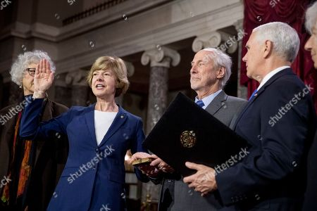 Mike Pence, Tammy Baldwin. Vice President Mike Pence administers the Senate oath of office to Sen. Tammy Baldwin, D-Wis., and members of her family during a mock swearing in ceremony in the Old Senate Chamber on Capitol Hill in Washington, as the 116th Congress begins