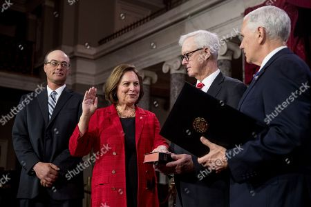 Stock Picture of Mike Pence, Deb Fischer, Bruce Fischer. Vice President Mike Pence administers a ceremonial Senate oath during a mock swearing-in ceremony to Sen. Deb Fischer, R-Neb., accompanied by her husband Bruce Fischer, in the Old Senate Chamber on Capitol Hill in Washington