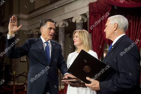 Stock Photo of Mike Pence, Mitt Romney, Ann Romney. Vice President Mike Pence administers the Senate oath of office to Sen. Mitt Romney, R-Utah, accompanied by his wife Ann, during a mock swearing in ceremony in the Old Senate Chamber on Capitol Hill in Washington, as the 116th Congress begins
