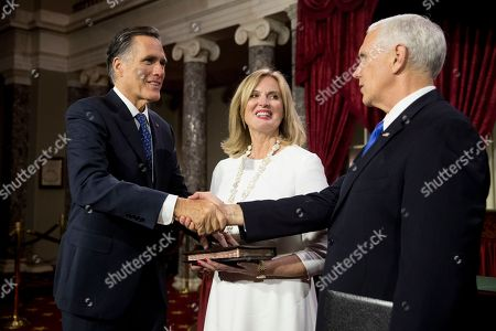 Stock Picture of Mike Pence, Mitt Romney, Ann Romney. Vice President Mike Pence shakes hands with Sen. Mitt Romney, R-Utah, accompanied by his wife Ann, following a mock swearing in ceremony in the Old Senate Chamber on Capitol Hill in Washington, as the 116th Congress begins