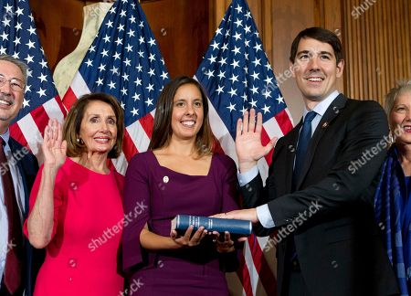 House Speaker Nancy Pelosi of Calif., administers the House oath of office to Rep. Josh Harder, D-Calif., during ceremonial swearing-in on Capitol Hill in Washington, during the opening session of the 116th Congress