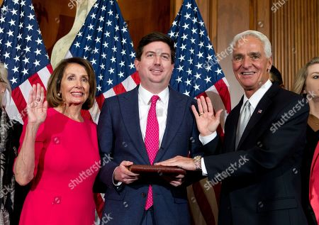 House Speaker Nancy Pelosi of Calif., administers the House oath of office to Rep. Charlie Crist, D-Fla., during ceremonial swearing-in on Capitol Hill in Washington, during the opening session of the 116th Congress