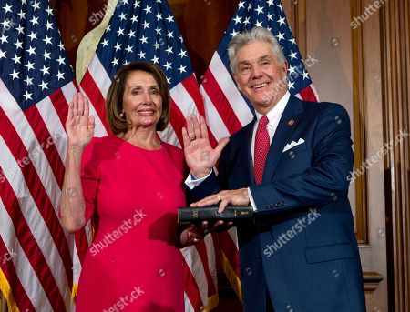 House Speaker Nancy Pelosi of Calif., administers the House oath of office to Rep. Roger Williams, R-Texas, during ceremonial swearing-in on Capitol Hill in Washington, during the opening session of the 116th Congress