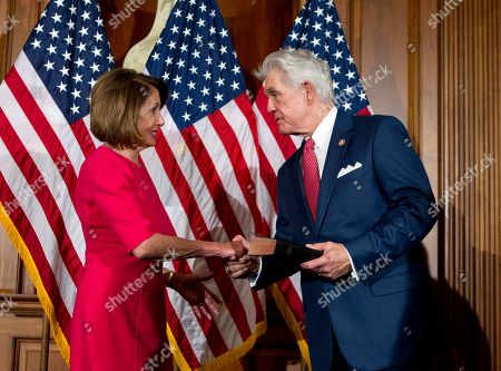 House Speaker Nancy Pelosi, of Calif., shakes hands with Rep. Roger Williams, R-Texas, during ceremonial swearing-in on Capitol Hill in Washington, at the opening session of the 116th Congress