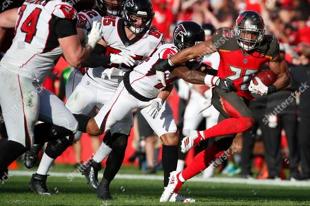 Tampa Bay Buccaneers defensive back Andrew Adams (26) returns an interception against the Atlanta Falcons during an NFL football game, in Tampa, Fla. The Falcons won 34-32