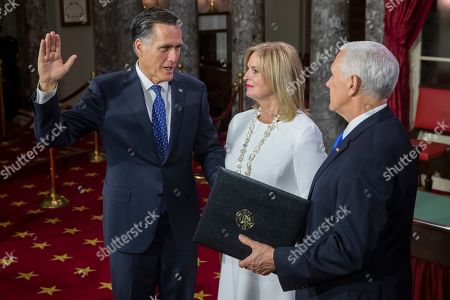 Republican Senator from Utah Mitt Romney (L) takes the oath of office from US Vice President Mike Pence (R) as Ann Romney (C) holds the Bible during the first day of the 116th Congress at the US Capitol in Washington, DC, USA, 03 January 2019.