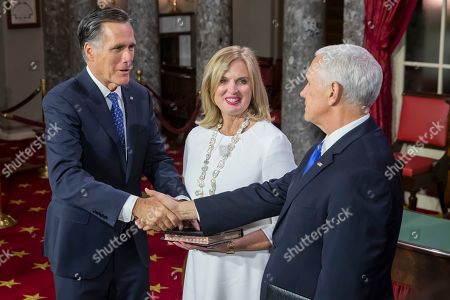 Stock Image of Republican Senator from Utah Mitt Romney (L) takes the oath of office from US Vice President Mike Pence (R) as Ann Romney (C) holds the Bible, during the first day of the 116th Congress at the US Capitol in Washington, DC, USA, 03 January 2019.