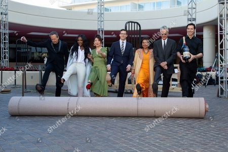 Stock Photo of Barry Adelman, Isan Elba, Sandra Oh, Andy Samberg, Meher Tatna, Allen Shapiro. Barry Adelman, from left, Isan Elba, Sandra Oh, Andy Samberg, Meher Tatna and Allen Shapiro roll-up the red carpet at the 76th Annual Golden Globe Awards Preview Day at The Beverly Hilton, in Beverly Hills, Calif