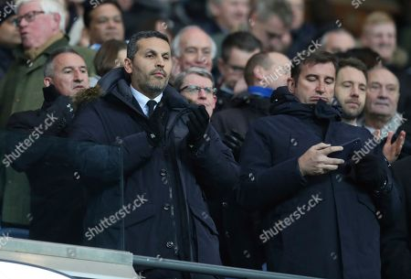 The Chairman of Manchester City football club Khaldoon Al Mubarak, left, applauds as the tams walk out onto the pitch ahead of the English Premier League soccer match between Manchester City and Liverpool at the Ethiad stadium, Manchester England