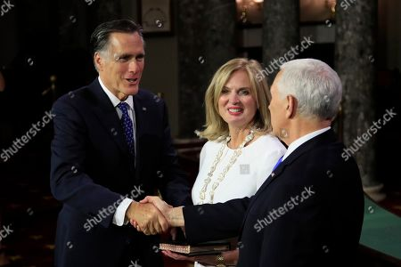 Mike Pence, Mitt Romney, Ann Romney. Vice President Mike Pence shakes hands with Sen. Mitt Romney, R-Utah, accompanied by his wife Ann Romney, during a mock swearing-in ceremony, in the Old Senate Chamber on Capitol Hill in Washington