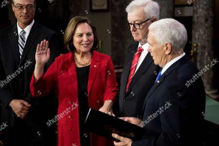 Mike Pence, Deb Fischer, Bruce Fischer. Vice President Mike Pence administers a ceremonial Senate oath during a mock swearing-in ceremony to Sen. Deb Fischer, R-Neb., accompanied by her husband Bruce Fischer, in the Old Senate Chamber on Capitol Hill in Washington