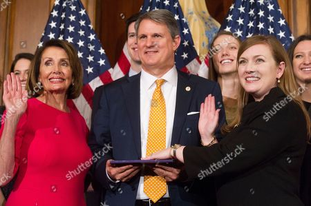 Stock Image of House Speaker Nancy Pelosi of Calif., right, poses during a ceremonial swearing-in with Rep. Lizzie Pannill Fletcher, D-Texas, on Capitol Hill in Washington, during the opening session of the 116th Congress. Washington, Thursday, Jan. 3, 2019