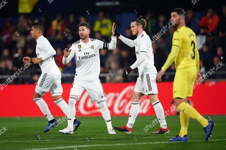 Sergio Ramos of Real Madrid celebrates with Gareth Bale the Raphael Varane goal