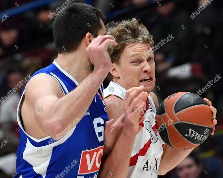 Armani Exchange Milano Mindaugas Kuzminskas goes for the basket against Buducnost's Filip Barovic during their Euroleague basketball match at the Assago Forum, Milan, 03 January 2019.