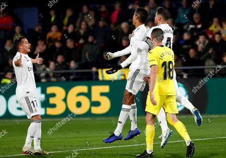Raphael Varane, Sergio Ramos, Lucas Vazquez. Real Madrid's Raphael Varane, second right, celebrates with teammates Sergio Ramos, right, and Lucas Vazquez after scoring against Villarreal during a Spanish La Liga soccer match at the Ceramica stadium in Villarreal, Spain, on