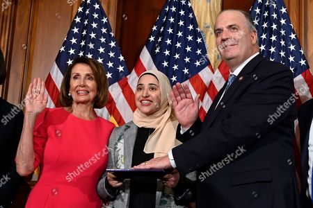 Stock Photo of Nancy Pelosi, Dan Kildee. House Speaker Nancy Pelosi of Calif., left, poses during a ceremonial swearing-in with Rep. Dan Kildee, D-Mich., right, on Capitol Hill in Washington, during the opening session of the 116th Congress