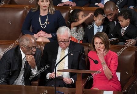 Nancy Pelosi, James Clyburn, Steny Hoyer, Paul Ryan. From left, House Majority Whip James Clyburn, D-S.C., House Majority Leader Steny Hoyer, D-Md., and House Democratic Leader Nancy Pelosi of California, tally the votes for Pelosi to become House speaker on the opening day of the 116th Congress, at the Capitol in Washington