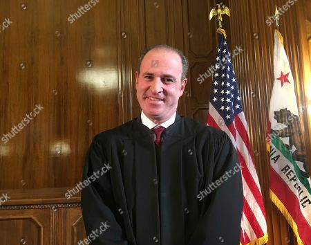 California governor's senior legal adviser Joshua Groban poses for a photo as he is sworn in as California's next Supreme Court justice in Sacramento, Calif., . California Gov. Jerry Brown has sworn in former top adviser Groban to the state Supreme Court in what aides say is likely to be his final public appearance before leaving office next week