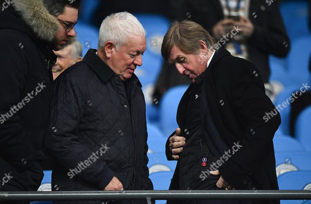 Former Liverpool player Kenny Dalglish shows off a heated jacket