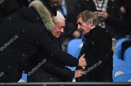 Former Liverpool player Kenny Dalglish shows off a heated jacket allowing people to feel the heat