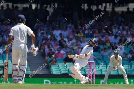 Cheteshwar Pujara (C) of India ducks under a bouncer from Australia's Patrick Cummins during day two of the fourth Test match between Australia and India at the Sydney Cricket Ground (SCG) in Sydney, Australia, 04 January 2019.