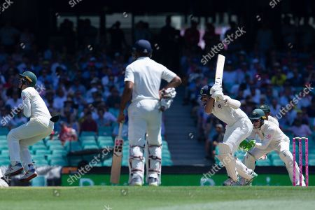 Cheteshwar Pujara (3-R) of India hits a boundary for his 150th run from Australia's Patrick Cummins during day two of the fourth Test match between Australia and India at the Sydney Cricket Ground (SCG) in Sydney, Australia, 04 January 2019.