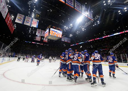 The New York Islanders celebrate with Devon Toews (25) after Toews scored  the in ... bc3f51785