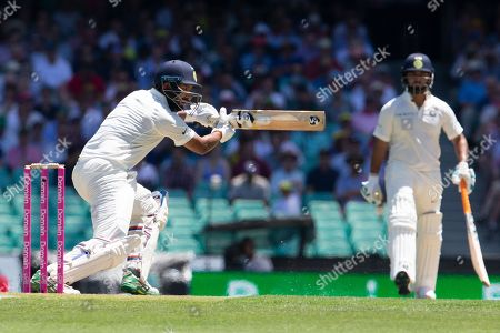 Cheteshwar Pujara of India batting from Australia's Patrick Cummins during day two of the fourth Test match between Australia and India at the Sydney Cricket Ground (SCG) in Sydney, Australia, 04 January 2019.
