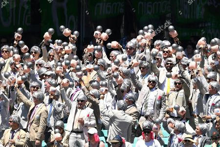 Stock Photo of A supporter group know as The Richies, named after former Australian cricketer Richie Benaud, are seen in the crowd during day two of the fourth Test match between Australia and India at the Sydney Cricket Ground (SCG) in Sydney, Australia, 04 January 2019.