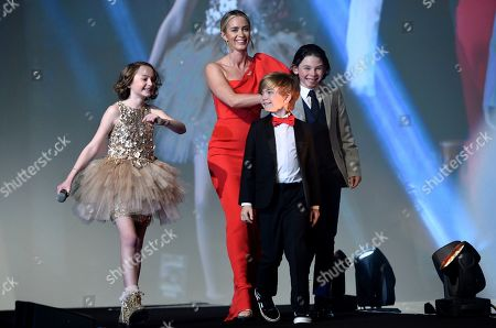 """Pixie Davies, Emily Blunt, Joel Dawson, Nathanael Saleh. Pixie Davies, from left, Emily Blunt, Joel Dawson, and Nathanael Saleh, of the cast of """"Mary Poppins Returns,"""" appear on stage to accept the ensemble performance award at the 30th annual Palm Springs International Film Festival, in Palm Springs, Calif"""