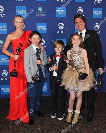 """Rob Marshall, Emily Blunt, Nathanael Saleh, Joel Dawson, Pixie Davies. Rob Marshall, background right, and the recipients of the ensemble performance award for """"Mary Poppins Returns,"""" from left, Emily Blunt, Nathanael Saleh, Joel Dawson, and Pixie Davies pose in the press room at the 30th annual Palm Springs International Film Festival, in Palm Springs, Calif"""