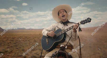 Tim Blake Nelson as Buster Scruggs