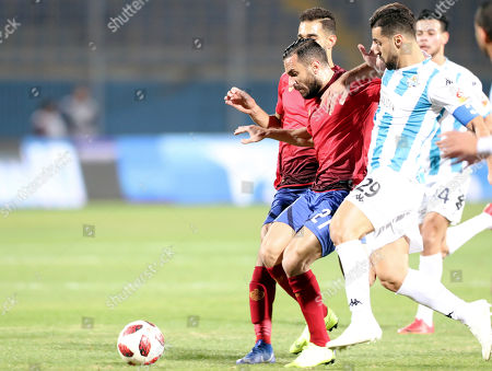 Al-Ahly  player Ali Maaloul (L)  in action against  Pyramids player Abdallah Said  (R) during the Egyptian league soccer match between Pyramids and Al-Ahly in Cairo, Egypt, 04 January 2019.