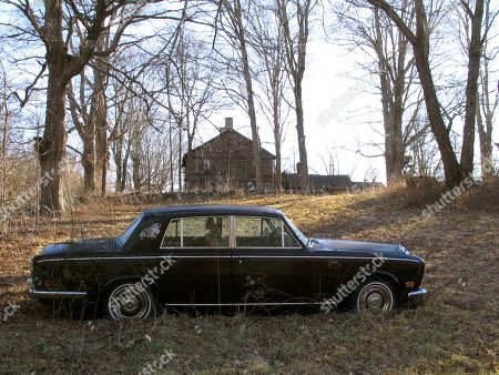 Stock Photo of A Rolls-Royce automobile sits on the Caprilands herb farm of the late famed herbalist Adelma Grenier Simmons, in Coventry, Conn. Simmons, who died in 1997 at age 93, is credited with reintroducing and popularizing the use of herbs in American cooking. Her widower Edward Cook, accused of failing to maintain the property, is fighting an eviction order