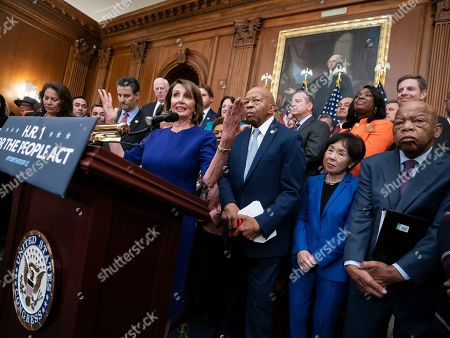 """Stock Photo of Nancy Pelosi, John Sarbanes, Elijah Cummings, John Lewis, Veronica Escobar, Doris Matsui, Paul Ryan. Speaker of the House Nancy Pelosi of Calif., and House Democrats, now in the majority, unveil a comprehensive elections and ethics reform package that targets what they call a """"culture of corruption in Washington"""" and aims to reduce the role of money in politics, at the Capitol in Washington, . She is joined from left by Rep. Veronica Escobar, D-Texas, Rep. John Sarbanes, D-Md., Rep. Elijah Cummings, D-Md., chairman of the Committee on Oversight and Government Reform, Rep. Doris Matsui, D-Calif., and Rep. John Lewis, D-Ga"""
