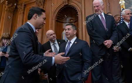 """Ben Ray Lujan, Joaquin Castro, Paul Ryan. Assistant Democratic Leader Ben Ray Lujan, D-N.M., center, listens to Rep. Joaquin Castro, D-Texas, left, as House Democrats assemble to announce a comprehensive elections and ethics reform package that targets what they call a """"culture of corruption in Washington,"""" at the Capitol in Washington"""