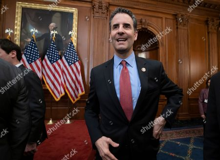 """John Sarbanes, Paul Ryan. Rep. John Sarbanes, D-Md., who chairs the House Democracy Reform Task Force, smiles after Democrats announced a comprehensive elections and ethics reform package that targets what they call a """"culture of corruption in Washington,"""" at the Capitol in Washington"""