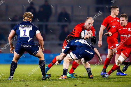 Schalk Burger of Saracens is tackled by Tom Curry of Sale Sharks