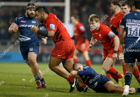 Billy Vunipola of Saracens is tackled by James O?Connor of Sale