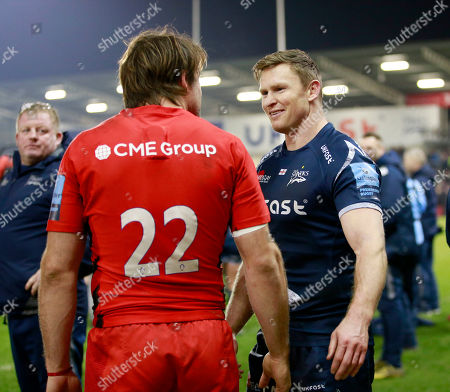 Chris Ashton of Sale Sharks talking with his former teammate Marcelo Bosch of Saracens after the game