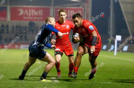Stock Photo of Billy Vunipola beats James O?Connor of Sale and scores the opening Try of the game for Saracens
