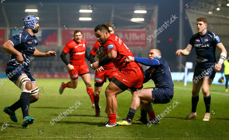 Billy Vunipola beats James O?Connor of Sale to score the opening Try of the game for Saracens