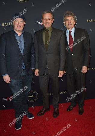 Stock Picture of Kevin Feige, Bob Iger, Alan F. Horn. Kevin Feige, from left, Bob Iger, and Alan F. Horn arrive at the AFI Awards at The Four Seasons, in Los Angeles