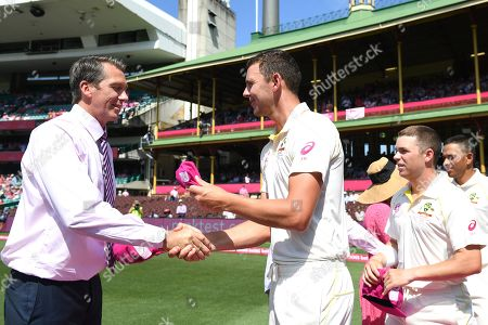 Australian bowler Josh Hazlewood presents his pink cap to Glenn McGrath ahead of play on day three of the Fourth Test match between Australia and India at the SCG in Sydney, Australia, 05 January 2019.