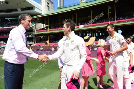 Australian captain Tim Paine presents his pink cap to Glenn McGrath ahead of play on day three of the Fourth Test match between Australia and India at the SCG in Sydney, Australia, 05 January 2019.