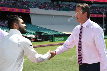 Indian captain Virat Kohli presents his pink cap to Glenn McGrath ahead of play on day three of the Fourth Test match between Australia and India at the SCG in Sydney, Australia, 05 January 2019.