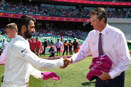 Indian batter Cheteshwar Pujara presents his pink cap to Glenn McGrath ahead of play on day three of the Fourth Test match between Australia and India at the SCG in Sydney, Australia, 05 January 2019.